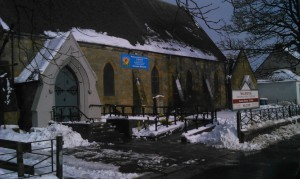 Church with snow and sunshine